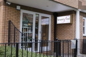 Salon with brick wall and beautyfini sign